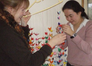 Alison and Marika with paper origami cranes