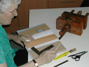Mary constructing the book