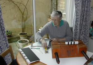 Mary using the finishing press
